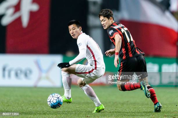 Shanghai FC Forward Wu Lei fights for the ball with FC Seoul Defender Shin Kwang Hoon during the AFC Champions League 2017 Group F match between FC...