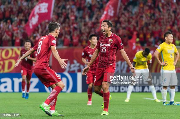 Shanghai FC Midfielder Akhmedov Odil celebrating his score with Oscar Emboaba Junior during the AFC Champions League 2017 Round of 16 match between...