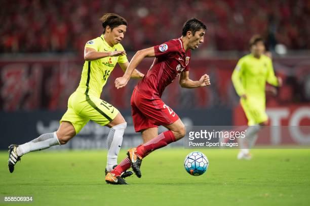 Shanghai FC Midfielder Akhmedov Odil in action against Urawa Reds Midfielder Nagasawa Kazuki during the AFC Champions League 2017 SemiFinals match...