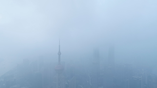 Shanghai Financial Center and modern skyscraper city in mist - gettyimageskorea
