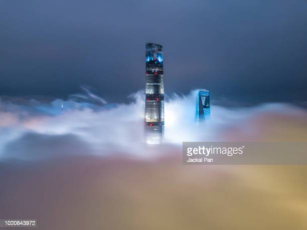 shanghai financial district in fog - international landmark stock pictures, royalty-free photos & images