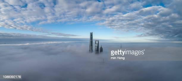 shanghai financial district in fog - luogo d'interesse internazionale foto e immagini stock