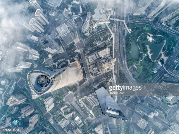 shanghai financial district in fog - lujiazui stock photos and pictures