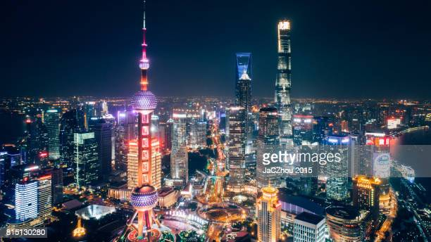 shanghai financial district landmark at night - lujiazui stock pictures, royalty-free photos & images