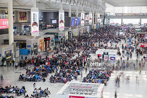 Shanghai Hongqiao Railway Station crowded with travelers This railway station is one of the most advanced and only serves highspeed bullet trains It...