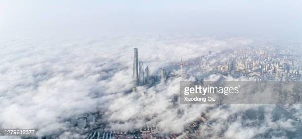 shanghai in clouds - shanghai stock pictures, royalty-free photos & images
