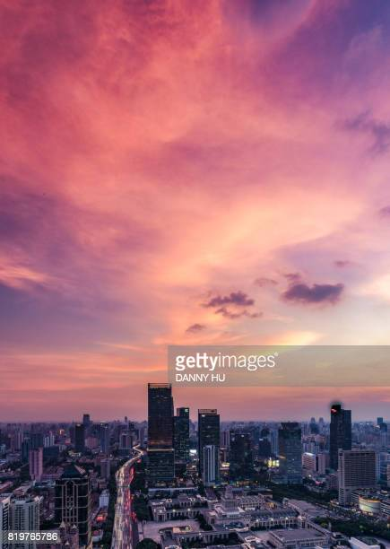 shanghai jin an district skyline at dusk - rose colored stock pictures, royalty-free photos & images