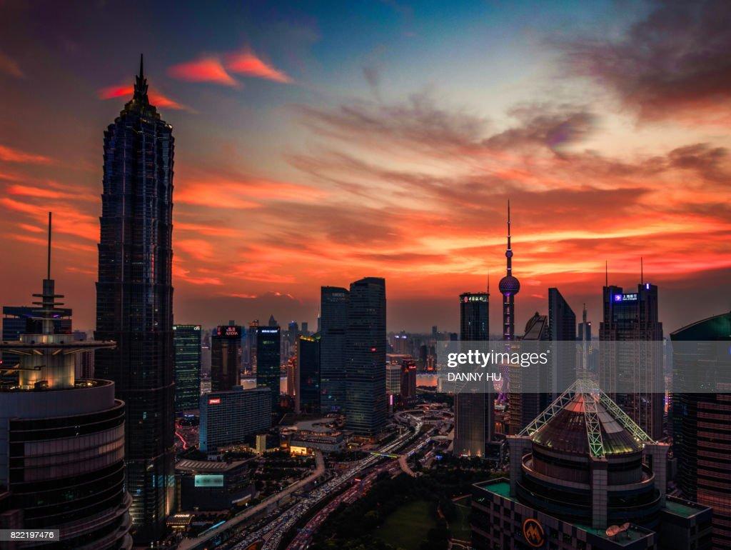 Shanghai Lujiazui skyline with glowing clouds : Stock Photo