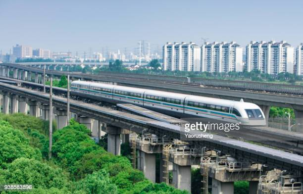 shanghai magnetic levitation (maglev) train departure for pudong airport.this train link pudong international airport with shanghai downtown area. - 高速列車 ストックフォトと画像