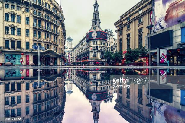shanghai nanjing road with reflection in the water - nanjing road stock pictures, royalty-free photos & images