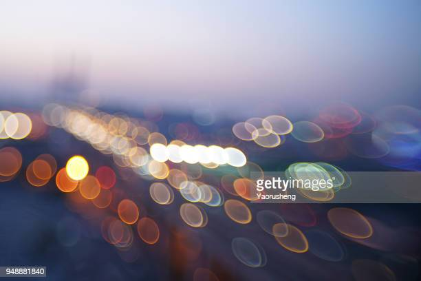 shanghai nanpu bridge cityscape at night with lights blurred into bokeh circles background.taken by tilt and shift lens - 水の流れ ストックフォトと画像