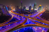 Shanghai neon night highway futuristic illuminated skyscrapers China