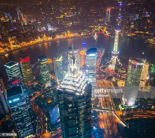 Shanghai neon night skyscrapers of Pudong overlooking The Bund China
