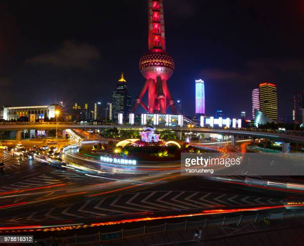 Shanghai Orient Pearl Tower illuminated in red in the night,celebrating a Chinese traditional holiday,China
