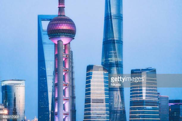 shanghai, oriental pearl tower and pudong skyscrapers, china - oriental pearl tower shanghai stock pictures, royalty-free photos & images