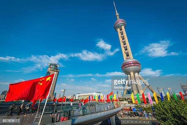 Shanghai Oriental Pearl Tower Chinese Flag and tourists Pudong China