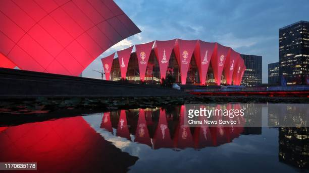 Shanghai Oriental Sports Center, a venue for the 2019 FIBA Basketball World Cup, is illuminated in red on August 27, 2019 in Shanghai, China. The...