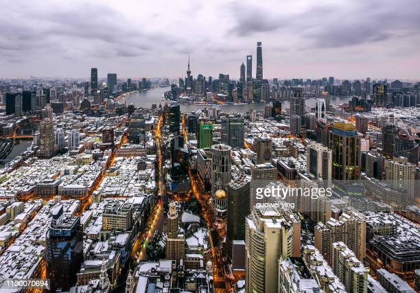 shanghai panoramic skyline under heavy snow - 塔 stock pictures, royalty-free photos & images