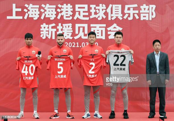 Shanghai Port FC's new signings Abulahan Harik, Ante Majstorovic, Li Ang and Du Jia attend their presentation ceremony with general manager of...