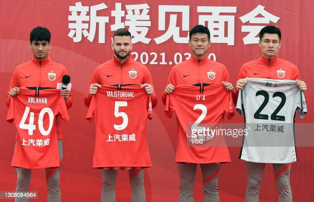 Shanghai Port FC's new signings Abulahan Harik, Ante Majstorovic, Li Ang and Du Jia attend their presentation ceremony on March 20, 2021 in Shanghai,...