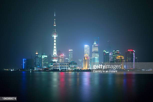 shanghai pudong skyline at night - shanghai stock pictures, royalty-free photos & images