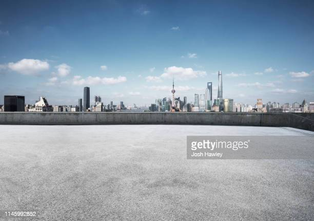 shanghai rooftop and parking lot - roof stock pictures, royalty-free photos & images