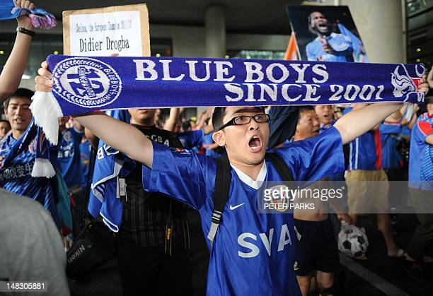 Shanghai Shenhua fans shout after former Chelsea football star Didier Drogba arrived at Pudong international airport in Shanghai on July 14 2012...