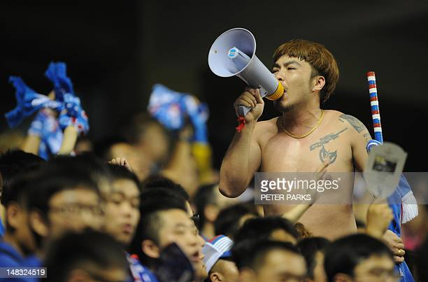 Shanghai Shenhua FC fans watch their team play Beijing Guo An at Hongkou Stadium in Shanghai on July 14 2012 Football star Didier Drogba was given a...