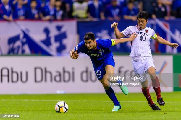 Shanghai Shenhua Midfielder Giovanni Moreno fights for the ball with Kashima Midfielder Ogasawara Mitsuo during the AFC Champions League 2018 Group...