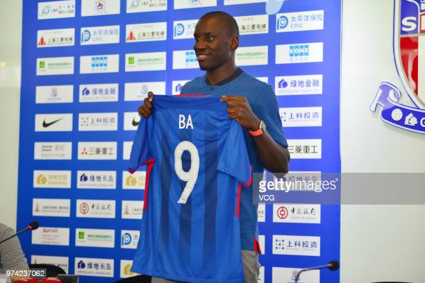Shanghai Shenhua new signing Demba Ba attends a press conference on June 14 2018 in Shanghai China