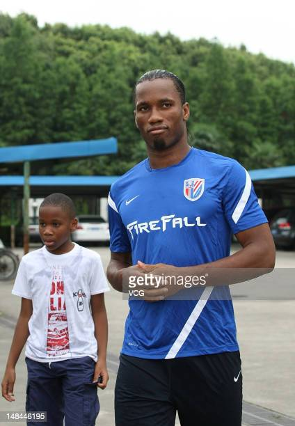 Shanghai Shenhua player Didier Drogba and his son Isaac are seen prior to a training session at Kangqiao Training Base on July 16 2012 in Shanghai...