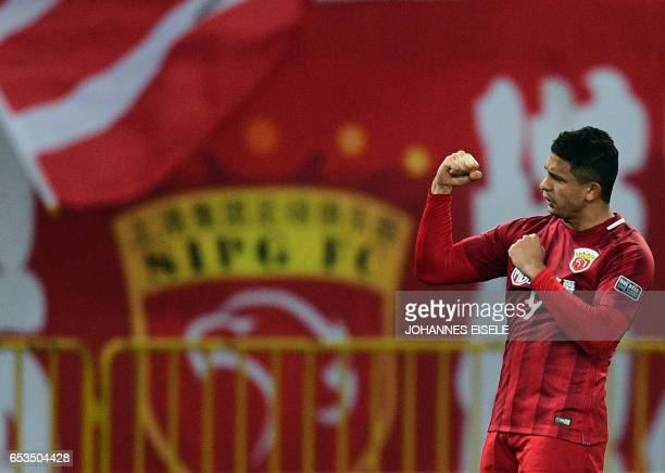 Shanghai SIPG' Brazilian forward Elkeson celebrates after scoring a goal during the AFC Asian Champions League group football match between China's...