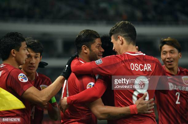 Shanghai SIPG' Brazilian forward Hulk celebrates his goal with Shanghai SIPG' Brazilian midfielder Oscar during the AFC Asian Champions League group...