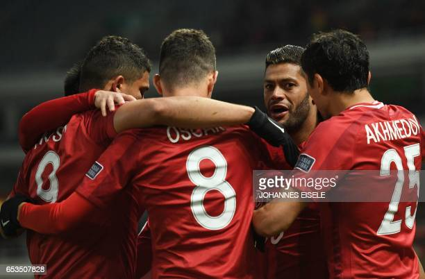 Shanghai SIPG' Brazilian forward Hulk celebrates with teammates after scoring a goal during the AFC Asian Champions League group football match...