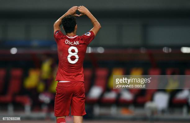 Shanghai SIPG Brazilian midfielder Oscar celebrates after scoring during the AFC Asian Champions League group match between the Shanghai SIPG and...