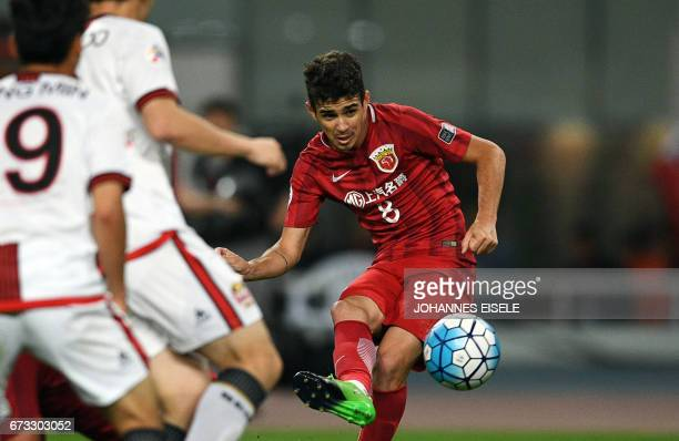 Shanghai SIPG Brazilian midfielder Oscar vies for the ball during the AFC Asian Champions League group match between the Shanghai SIPG and South...