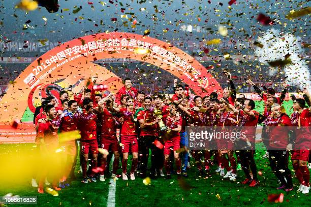 Shanghai SIPG celebrate after winning the Chinese Super League championship against Beijing Renhe during the 2018 Chinese Super League match at...