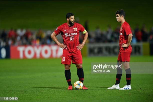 Shanghai SIPG FC players Hulk and Oscar Emboaba Junior wait for a penalty kick during their AFC Champions League football match against Sydney FC in...