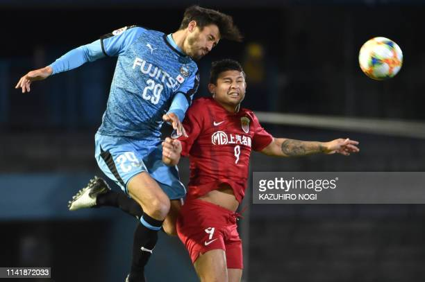 Shanghai SIPG forward Elkeson and Kawasaki Frontale defender Michael Fitzgerald fight for the ball during the AFC Champions League group stage...