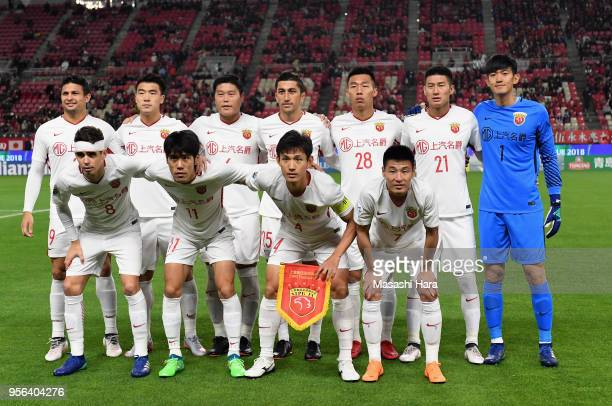 Shanghai SIPG players line up for the team photos prior to the AFC Champions League Round of 16 first leg match between Kashima Antlers and Shanghai...