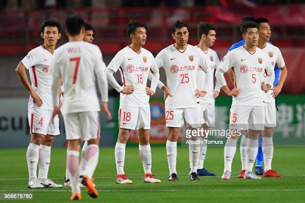 Shanghai SIPG players show dejection after their 13 defeat in the AFC Champions League Round of 16 first leg match between Kashima Antlers and...