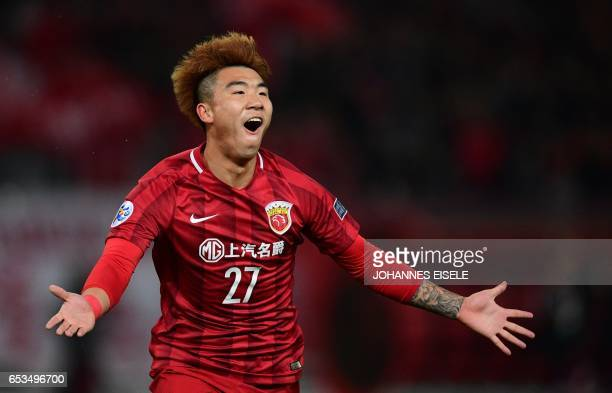 Shanghai SIPG' Shi Ke celebrates his goal during the AFC Asian Champions League group football match between China's Shanghai SIPG and Japan's Urawa...