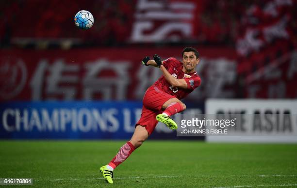 TOPSHOT Shanghai SIPG' Uzbekistan midfielder Akhmedov Odil kicks the ball during the AFC Asian Champions League group football match between China's...