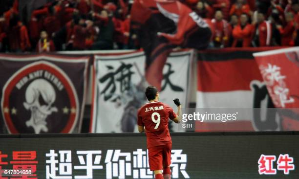 Shanghai SIPG's Brazilian forward Elkeson celebrates after scoring a goal during the Chinese Super League match against Changchun Yatai in Shanghai...