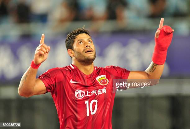 Shanghai SIPG's Brazilian forward Hulk celebrates after scoring during the AFC Champions League round of 16 football match Shanghai SIPG against...