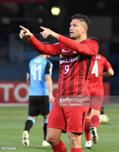 Shanghai SIPG's forward Elkeson reacts after scoring a goal during the AFC Champions League group F football match between Kawasaki Frontale and...