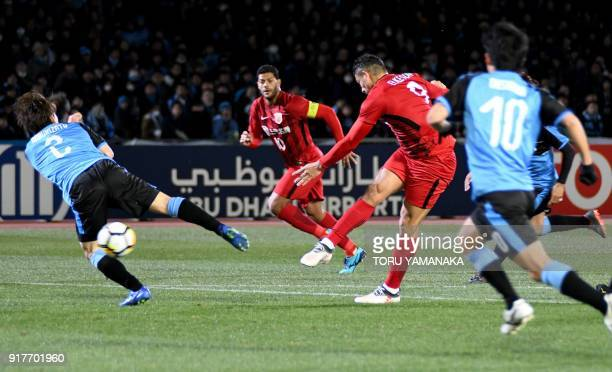 Shanghai SIPG's forward Elkeson shoots to score a goal during the AFC Champions League group F football match between Kawasaki Frontale and Shanghai...