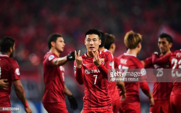 Shanghai SIPG's forward Wu Lei celebrates after scoring during the AFC Asian Champions League group football match between China's Shanghai SIPG and...