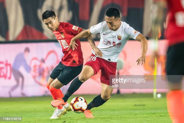 Shanghai SIPG's He Guan fights for the ball during the Chinese Super League football match between Guangzhou Evergrande and Shanghai SIPG in...