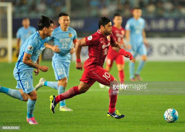 Shanghai SIPG's Hulk drives the ball during the AFC Champions League round of 16 football match Shanghai SIPG against Jiangsu Suning FC in Nanjing on...